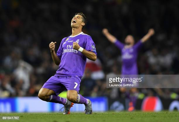 Cristiano Ronaldo of Real Madrid celebrates victory after the UEFA Champions League Final between Juventus and Real Madrid at National Stadium of...