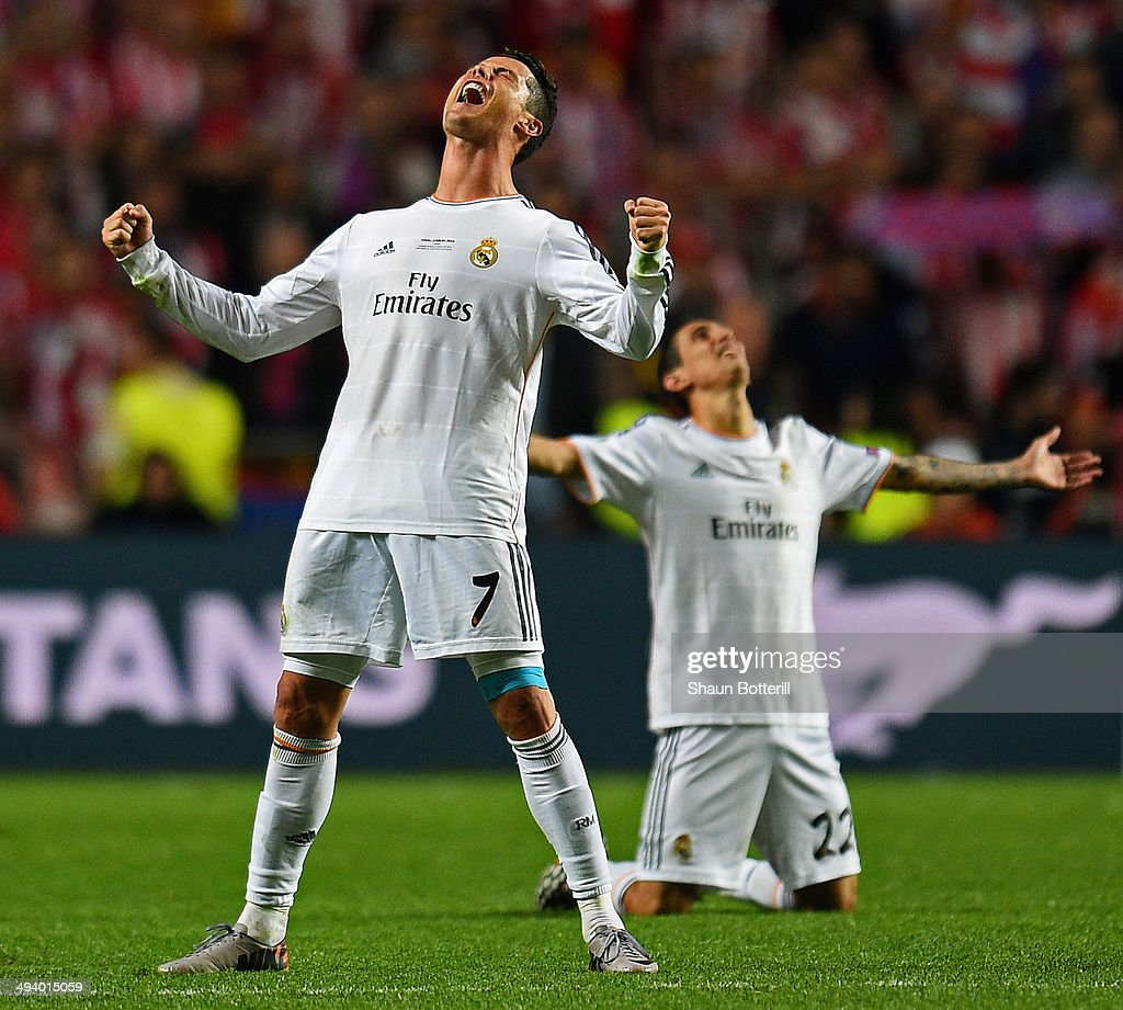 Cristiano Ronaldo of Real Madrid celebrates victory with Angel De Maria (R) after the UEFA Champions League Final between Real Madrid and Atletico de Madrid at Estadio da Luz on May 24, 2014 in Lisbon, Portugal.