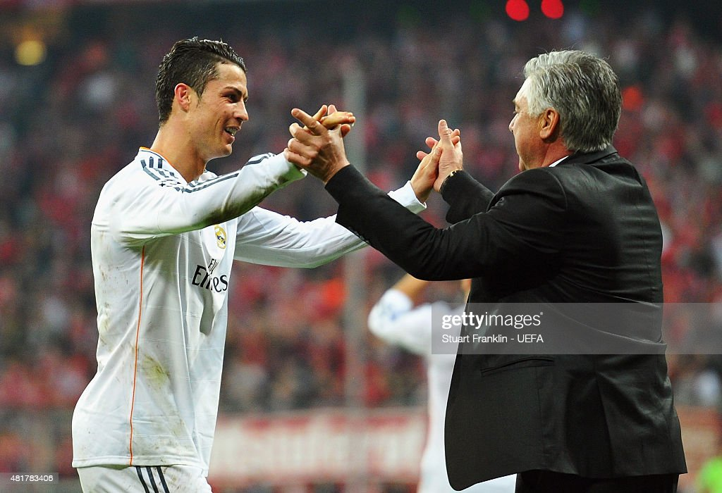 Cristiano Ronaldo of Real Madrid celebrates victory with Carlo Ancelotti, coach of Real Madrid after the UEFA Champions League Semi Final second leg match between FC Bayern Muenchen and Real Madrid at Allianz Arena on April 29, 2014 in Munich, Germany.