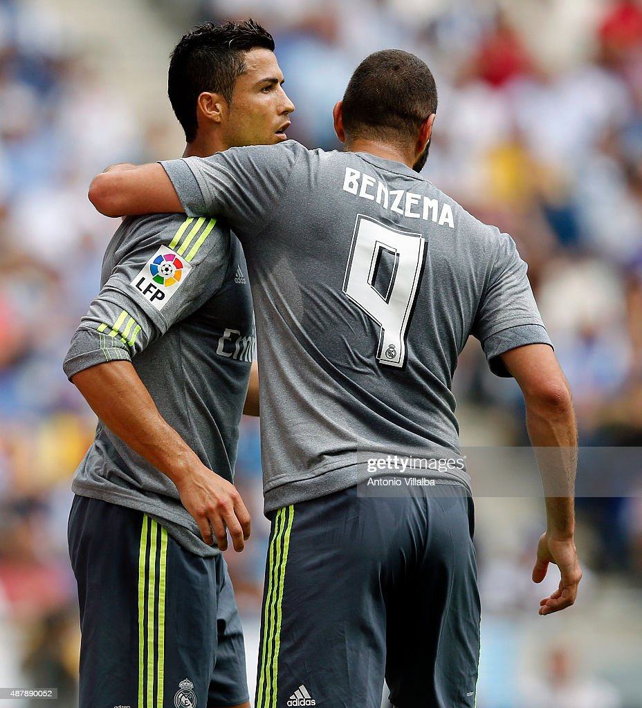Cristiano Ronaldo (L) of Real Madrid celebrates whit his teammate Karim Benzema after scoring a goal during the La Liga match between Espanyol and Real Madrid at Cornella-El Prat Stadium on September 12, 2015 in Barcelona, Spain.