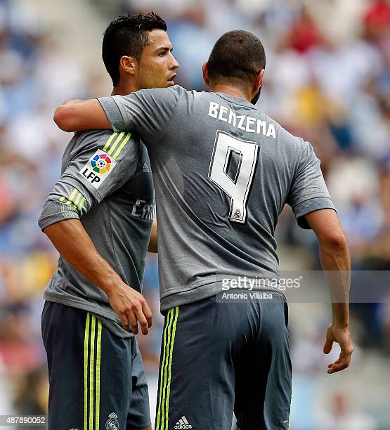 Cristiano Ronaldo of Real Madrid celebrates whit his teammate Karim Benzema after scoring a goal during the La Liga match between Espanyol and Real...