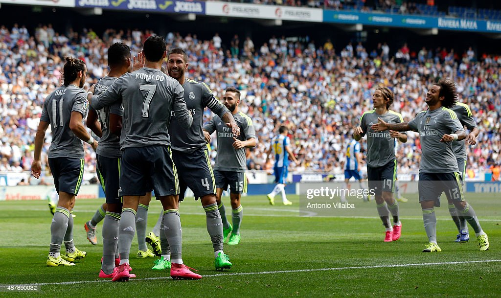 Cristiano Ronaldo of Real Madrid celebrates whit his teammates after scoring a goal during the La Liga match between Espanyol and Real Madrid at Cornella-El Prat Stadium on September 12, 2015 in Barcelona, Spain.