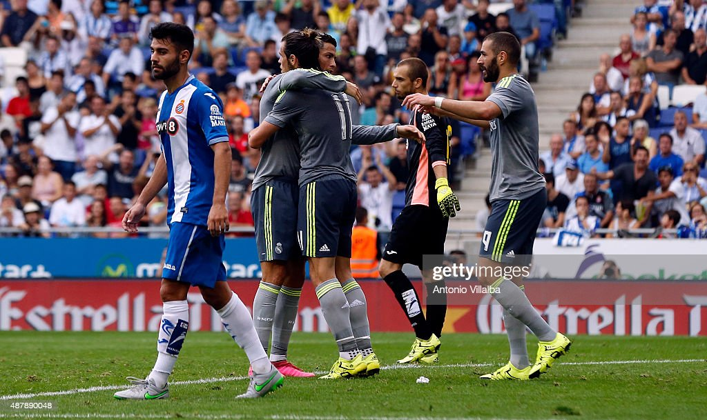 Cristiano Ronaldo (L) of Real Madrid celebrates whit his teammates Gareth Bale (C) and Karim Benzema after scoring a goal during the La Liga match between Espanyol and Real Madrid at Cornella-El Prat Stadium on September 12, 2015 in Barcelona, Spain.