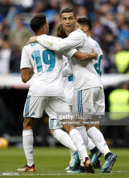 Cristiano Ronaldo of Real Madrid celebrates with Achraf Hakimi after scoring their team's third goal during the La Liga match between Real Madrid and...
