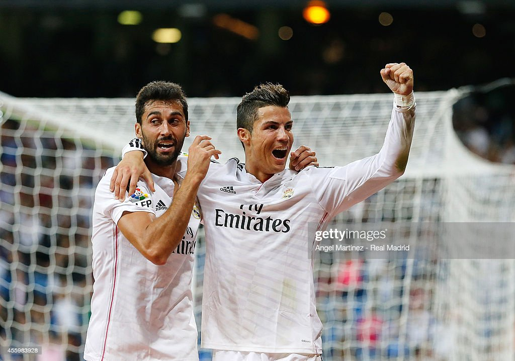 Cristiano Ronaldo of Real Madrid celebrates with Alvaro Arbeloa after scoring their team's fifth goal during the La Liga match between Real Madrid CF and Elche FC at Estadio Santiago Bernabeu on September 23, 2014 in Madrid, Spain.