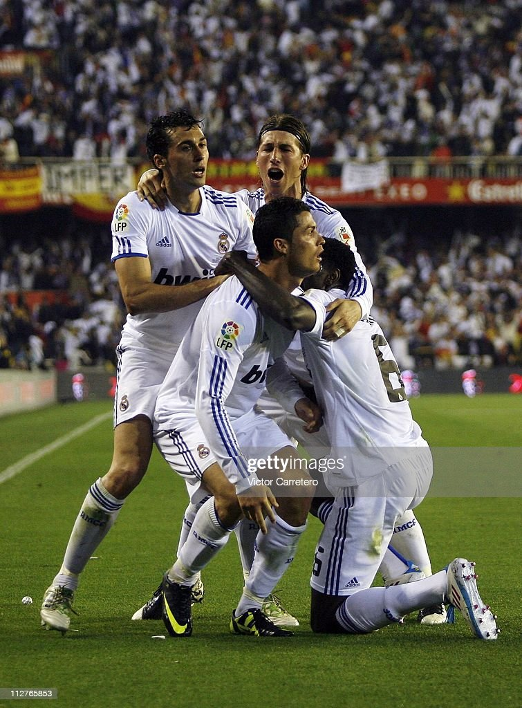 Cristiano Ronaldo (C) of Real Madrid celebrates with Alvaro Arbeloa (L), Sergio Ramos (Top) and Emmanuel Adebayor (R) after scoring the winning goal during the Copa del Rey Final between Barcelona and Real Madrid at Estadio Mestalla on April 20, 2011 in Valencia, Spain.