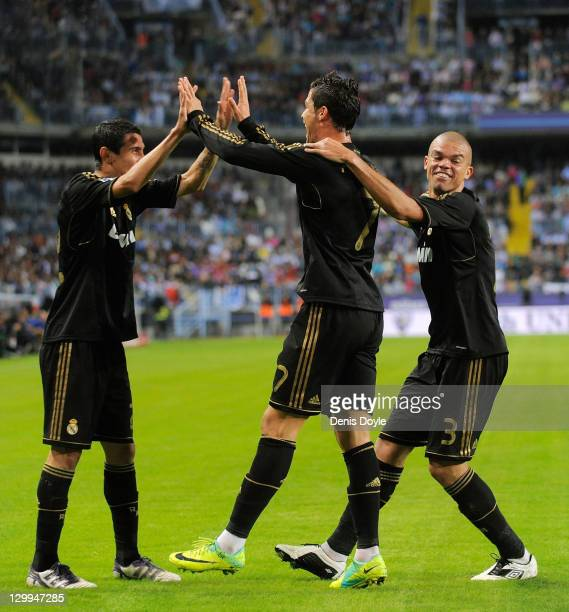 Cristiano Ronaldo of Real Madrid celebrates with Angel di Maria and Pepe after he scored his second goal during the La Liga match between Malaga CF...