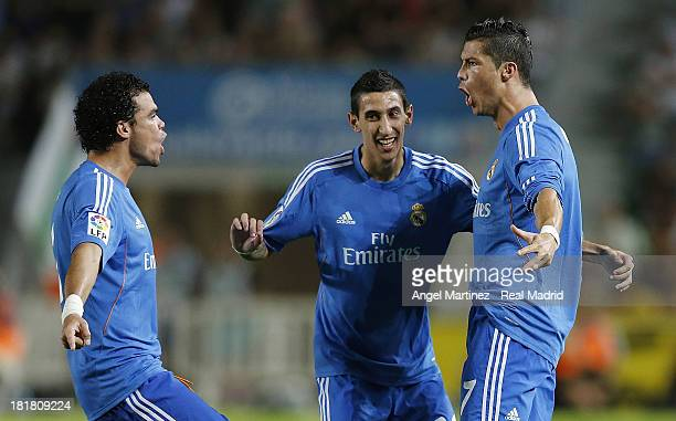 Cristiano Ronaldo of Real Madrid celebrates with Angel di Maria and Pepe after scoring the opening goal during the La Liga match between Elche FC and...