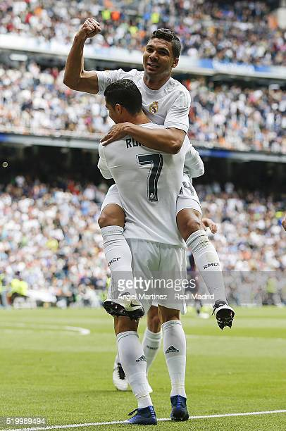 Cristiano Ronaldo of Real Madrid celebrates with Casemiro after scoring their team's third goal during the La Liga match between Real Madrid CF and...
