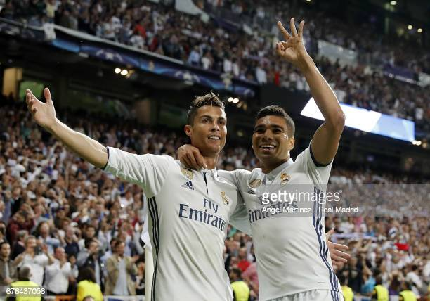 Cristiano Ronaldo of Real Madrid celebrates with Casemiro their team's third goal during the UEFA Champions League Semi Final first leg match between...