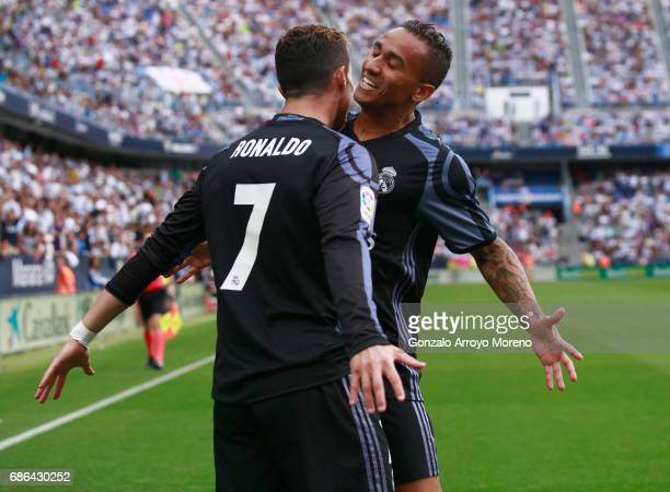 Cristiano Ronaldo of Real Madrid celebrates with Danilo of Real Madrid after he scores his sides first goal during the La Liga match between Malaga...