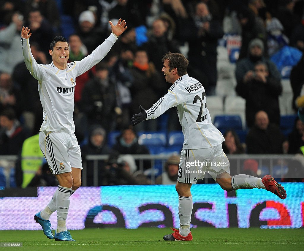 Cristiano Ronaldo (L) of Real Madrid celebrates with fellow goalscorer Rafael Van Der Vaart after scoring the 5:0 goal during the La Liga match between Real Madrid and Real Zaragoza at the Santiago Bernabeu stadium on December 19, 2009 in Madrid, Spain.