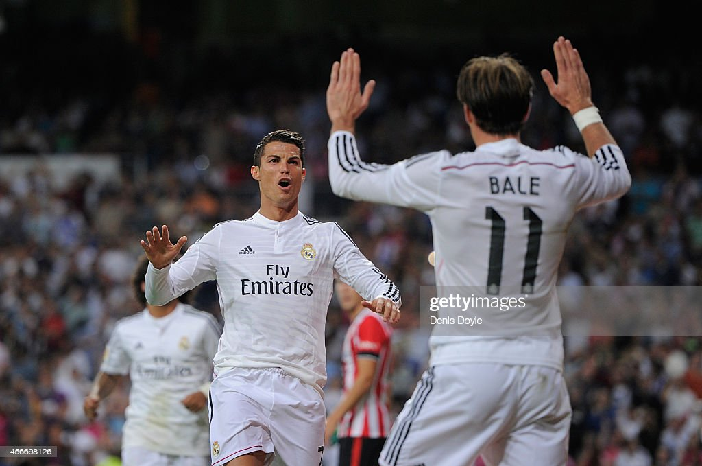 Cristiano Ronaldo of Real Madrid celebrates with Gareth Bale after scoring his team's 3rd goal during the La Liga match between Real Madrid CF and Athletic Club at Estadio Santiago Bernabeu on October 5, 2014 in Madrid, Spain.