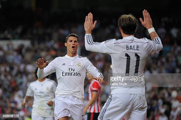 Cristiano Ronaldo of Real Madrid celebrates with Gareth Bale after scoring his team's 3rd goal during the La Liga match between Real Madrid CF and...