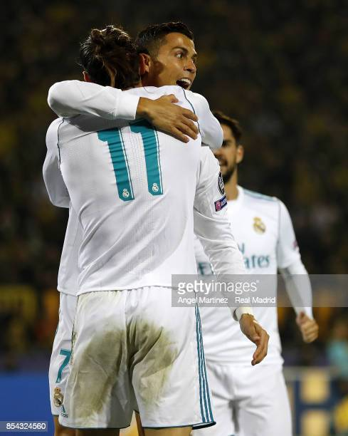 Cristiano Ronaldo of Real Madrid celebrates with Gareth Bale after scoring their team's second goal during the UEFA Champions League group H match...