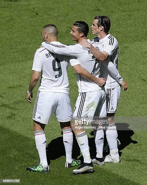 Cristiano Ronaldo of Real Madrid celebrates with Gareth Bale and Karim Benzema after scoring their team's fourth goal during the La Liga match...