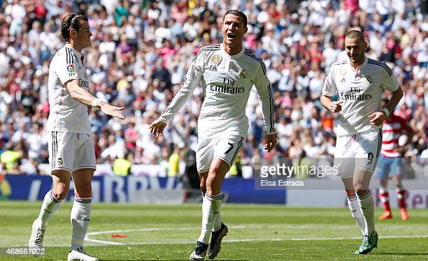 Cristiano Ronaldo of Real Madrid celebrates with Gareth Bale and Karim Benzema after scoring his second goal during the La Liga match between Real...