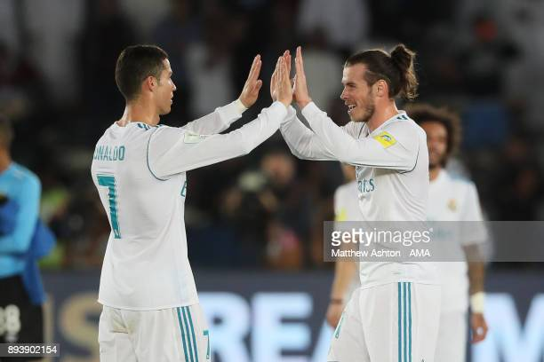 Cristiano Ronaldo of Real Madrid celebrates with Gareth Bale at the end of the FIFA Club World Cup UAE 2017 final match between Gremio and Real...