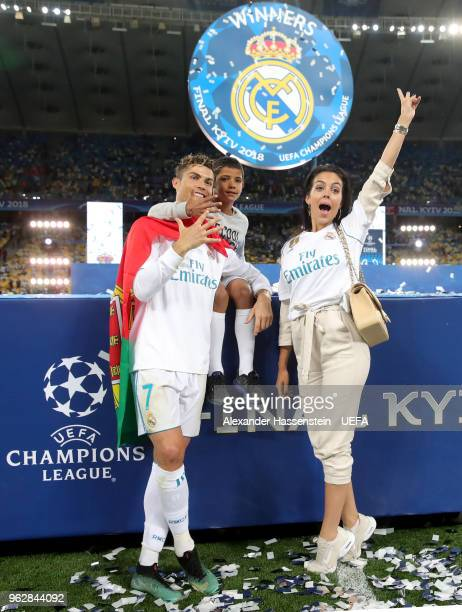 Cristiano Ronaldo of Real Madrid celebrates with Georgina Rodriguez and his son Cristiano Ronaldo jr following his sides victory in the UEFA...
