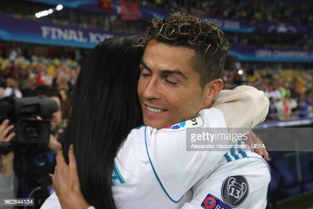 Cristiano Ronaldo of Real Madrid celebrates with Georgina Rodriguez following his sides victory in the UEFA Champions League Final between Real...