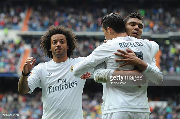 Cristiano Ronaldo of Real Madrid celebrates with Henrique Casemiro and Marcelo after scoring his team's 3rd goal during the La Liga match between...