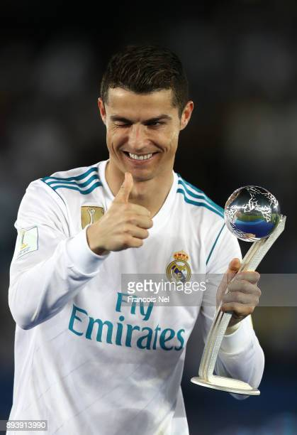 Cristiano Ronaldo of Real Madrid celebrates with his adidas Golden Ball trophy after the FIFA Club World Cup UAE 2017 Final between Gremio and Real...
