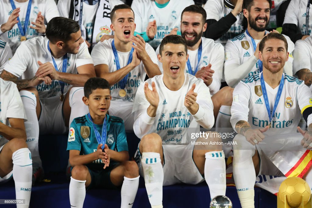 Cristiano Ronaldo of Real Madrid celebrates with his son Cristiano Ronaldo Jnr and his team-mates at the end of the FIFA Club World Cup UAE 2017 final match between Gremio and Real Madrid CF at Zayed Sports City Stadium on December 16, 2017 in Abu Dhabi, United Arab Emirates.