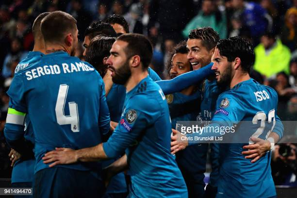Cristiano Ronaldo of Real Madrid celebrates with his team after scoring the opening goal during the UEFA Champions League Quarter Final first leg...