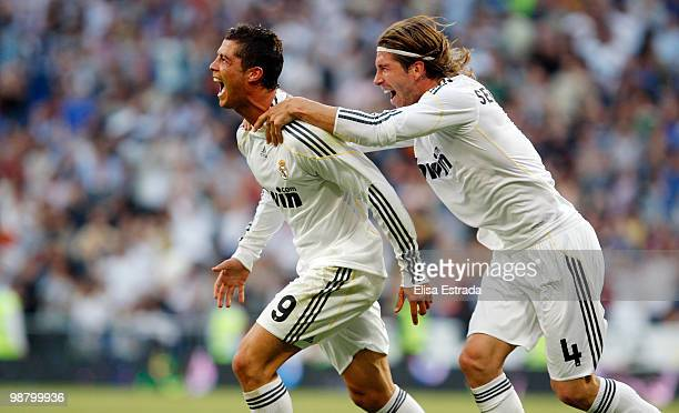 Cristiano Ronaldo of Real Madrid celebrates with his team mate Sergio Ramos after scoring during the La Liga match between Real Madrid and CA Osasuna...
