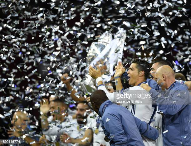 Cristiano Ronaldo of Real Madrid celebrates with his team mates after victory in the UEFA Champions League Final between Juventus and Real Madrid at...