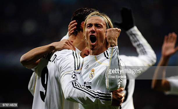 Cristiano Ronaldo of Real Madrid celebrates with his teammate Guti after scoring during the UEFA Champions League round of sixteen, second leg match...