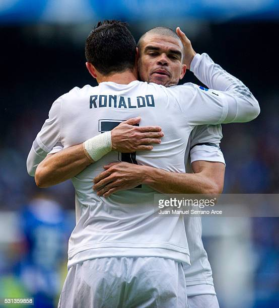 Cristiano Ronaldo of Real Madrid celebrates with his teammate Pepe of Real Madrid after scoring the opening goal during the La Liga match between RC...