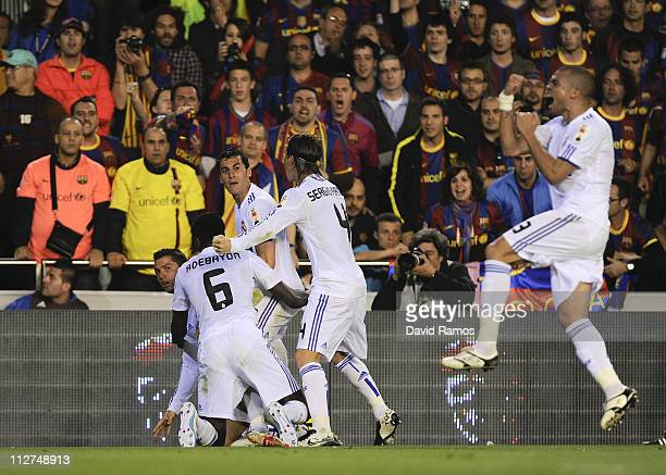 Cristiano Ronaldo of Real Madrid celebrates with his teammates after scoring his first team's goal during the Copa del Rey Final between Real Madrid...