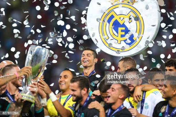 Cristiano Ronaldo of Real Madrid celebrates with his teammates after winning the UEFA Super Cup title in the final match against Manchester United at...