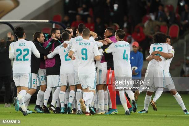 Cristiano Ronaldo of Real Madrid celebrates with his teammates afters scoring a goal to make it 01 during the FIFA Club World Cup UAE 2017 final...