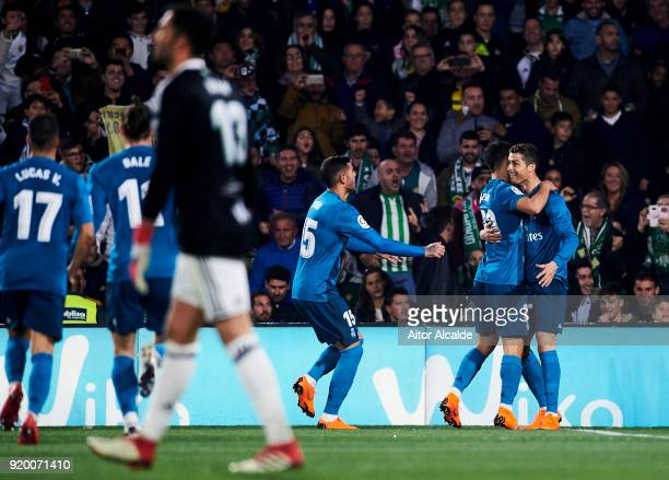 Cristiano Ronaldo of Real Madrid celebrates with his teammates Marco Asensio of Real Madrid after scoring his team's fourth goal during the La Liga...