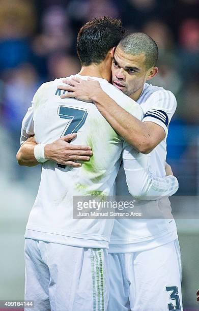 Cristiano Ronaldo of Real Madrid celebrates with his teammates Pepe of Real Madrid after scoring his team's second goal during the La Liga match...