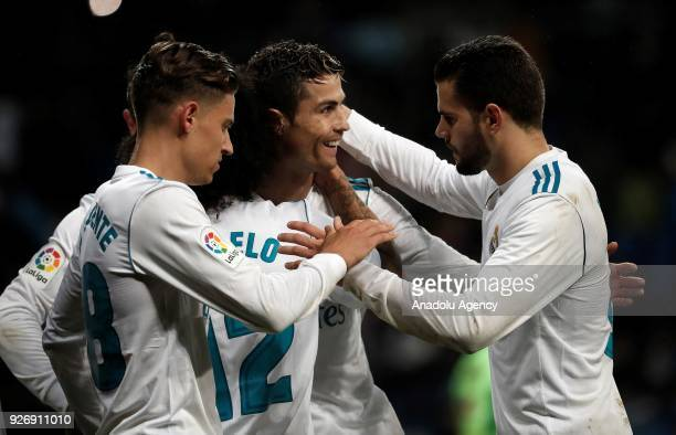 Cristiano Ronaldo of Real Madrid celebrates with his teammates Marcelo Vieira Marcos Llorente and Nacho Fernandez after scoring a goal during the La...