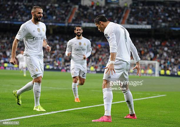 Cristiano Ronaldo of Real Madrid celebrates with Karim Benzema after scoring Real's 2nd goal from the penalty spot during the UEFA Champions League...