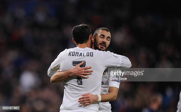 Cristiano Ronaldo of Real Madrid celebrates with Karim Benzema after scoring Real's 6th goal during the UEFA Champions League Group A match between...