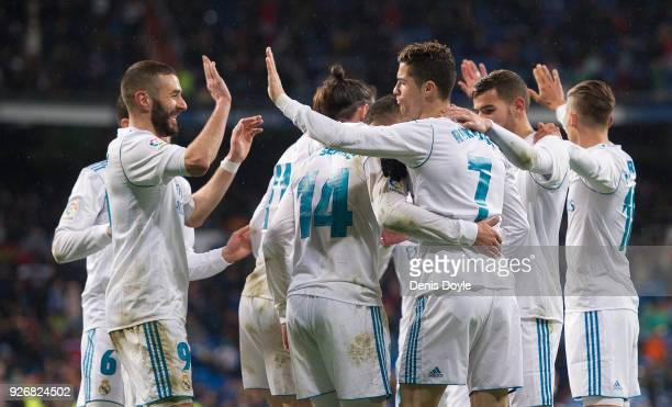 Cristiano Ronaldo of Real Madrid celebrates with Karim Benzema after scoring his teamÕs second goal during the La Liga match between Real Madrid and...