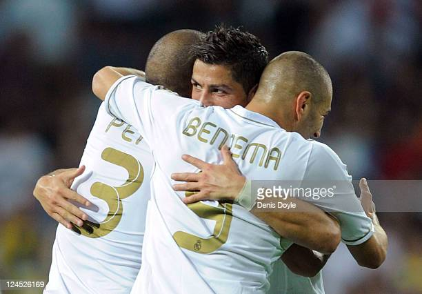 Cristiano Ronaldo of Real Madrid celebrates with Karim Benzema and Pepe after Benzema scored their third goal during the La Liga match bewteen Real...
