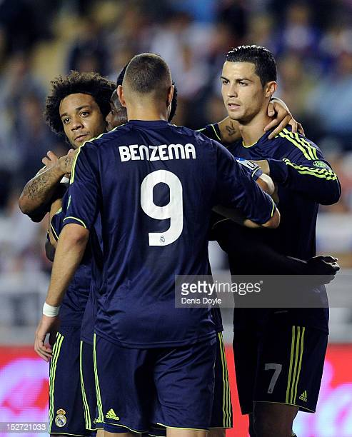 Cristiano Ronaldo of Real Madrid celebrates with Karom Benzema and Marcelo after scoring Real's 2nd goal during the La Liga match between Rayo...