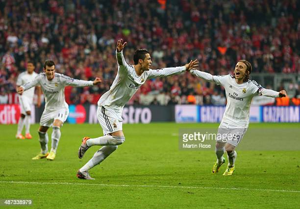 Cristiano Ronaldo of Real Madrid celebrates with Luka Modric and Gareth Bale as he scores their fourth goal during the UEFA Champions League...