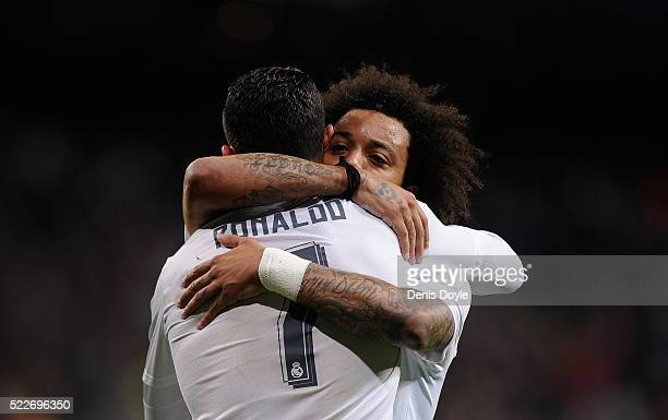 Cristiano Ronaldo of Real Madrid celebrates with Marcelo after Real scored their opening goal during the La Liga match between Real Madrid and...