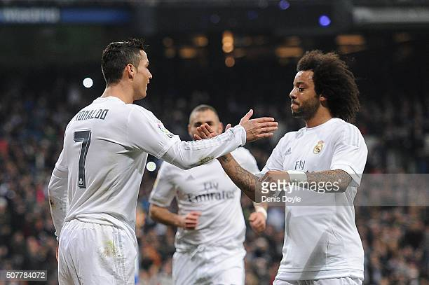 Cristiano Ronaldo of Real Madrid celebrates with Marcelo after scoring Real's 2nd goal during the La Liga match between Real Madrid CF and Real CD...