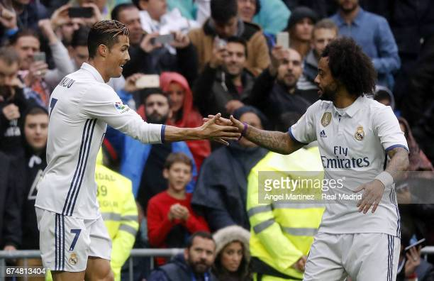 Cristiano Ronaldo of Real Madrid celebrates with Marcelo after scoring the opening goal during the La Liga match between Real Madrid and Valencia CF...