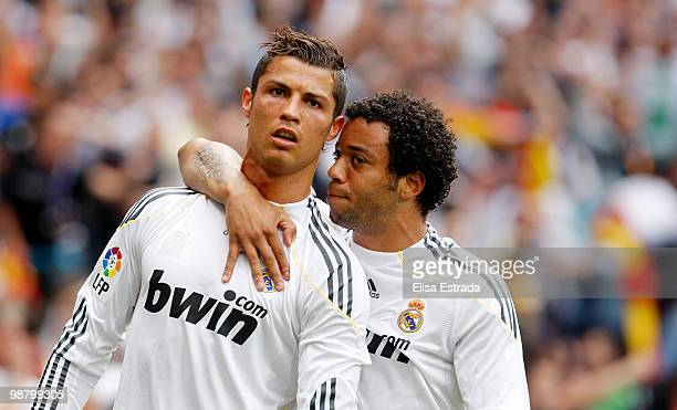 Cristiano Ronaldo of Real Madrid celebrates with Marcelo after scoring during the La Liga match between Real Madrid and CA Osasuna at Estadio...