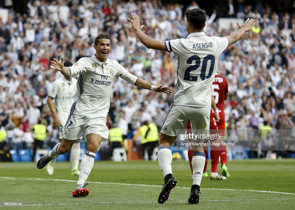 Cristiano Ronaldo (R) of Real Madrid celebrates with Marco Asensio after scoring their team's second goal during the La Liga match between Real Madrid and Sevilla FC at Estadio Santiago Bernabeu on May 14, 2017 in Madrid, Spain.