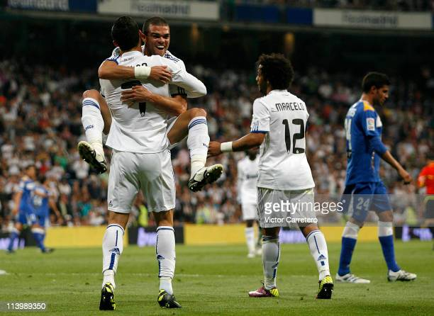 Cristiano Ronaldo of Real Madrid celebrates with Pepe after scoring his side opening goal during the La Liga match between Real Madrid and Getafe at...